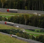 A car passes a slower moving truck, using a passing lane on the A2 motorway in Slovenia